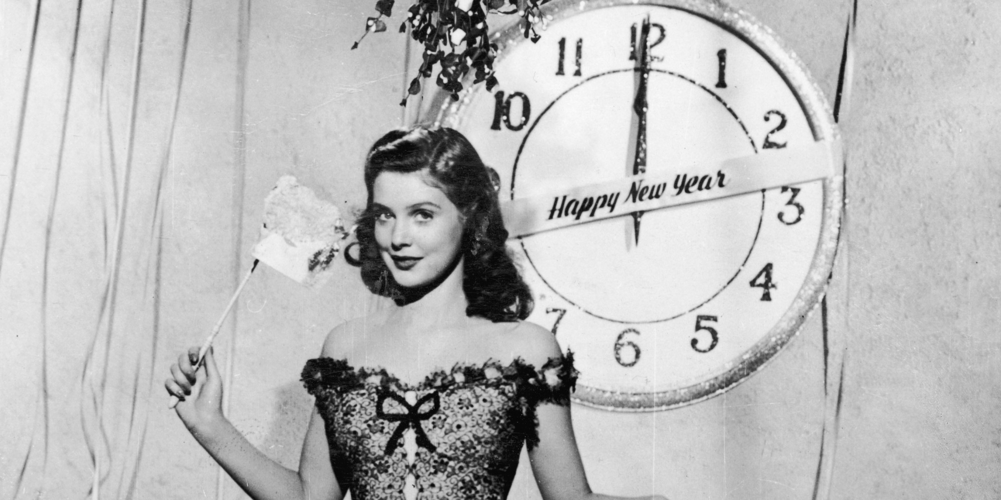 October 1950:  American model Joan Vohs poses for a new year greetings card.  (Photo by Keystone/Getty Images)